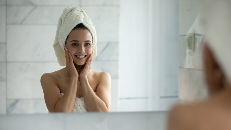 Woman Mirror Face Skincare Towel Covering Head
