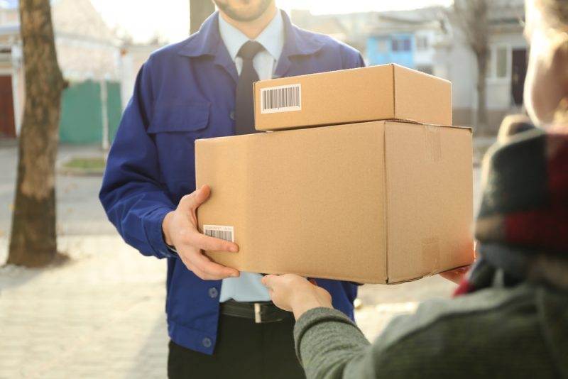 Woman Receiving Packages at Home