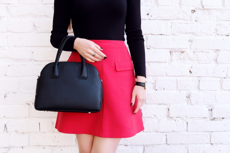 Woman Red Mini Skirt Black Bag cropped