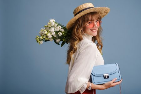 Woman Smiling Flowers Blue Bag Blouse Straw Hat