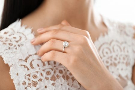 Woman Wearing Diamond Engagement Ring Lace Top