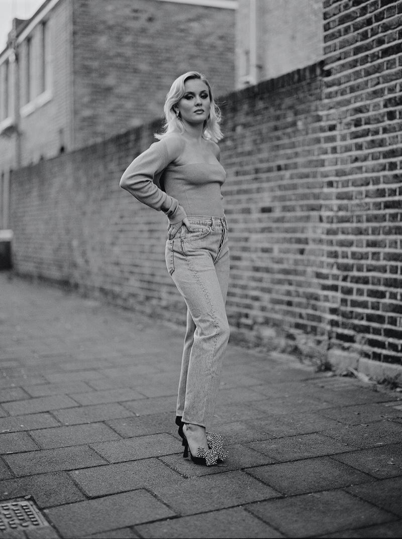Captured in black and white, Zara Larsson models denim. Photo: Luc Coiffait