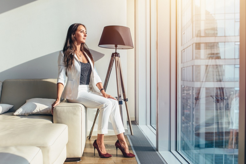 Attractive Woman Suit Looking Out Window Sun