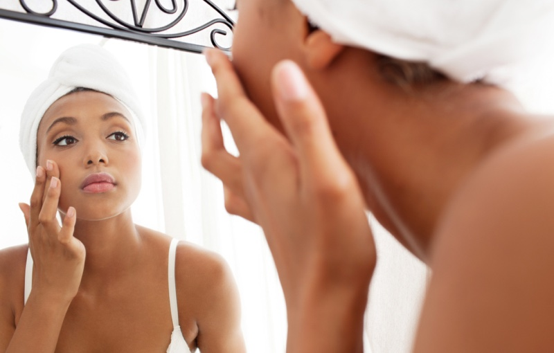 Black Woman Touching Face Skincare Applying Product Cream