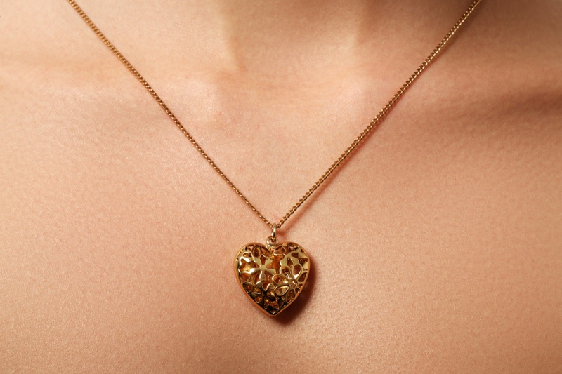 Closeup Gold Engraved Locket Necklace
