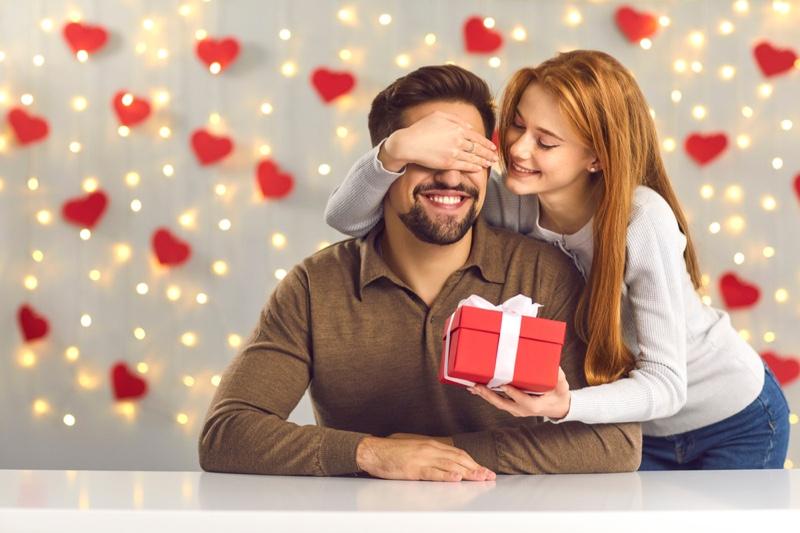 Couple Woman Giving Man Gift Box