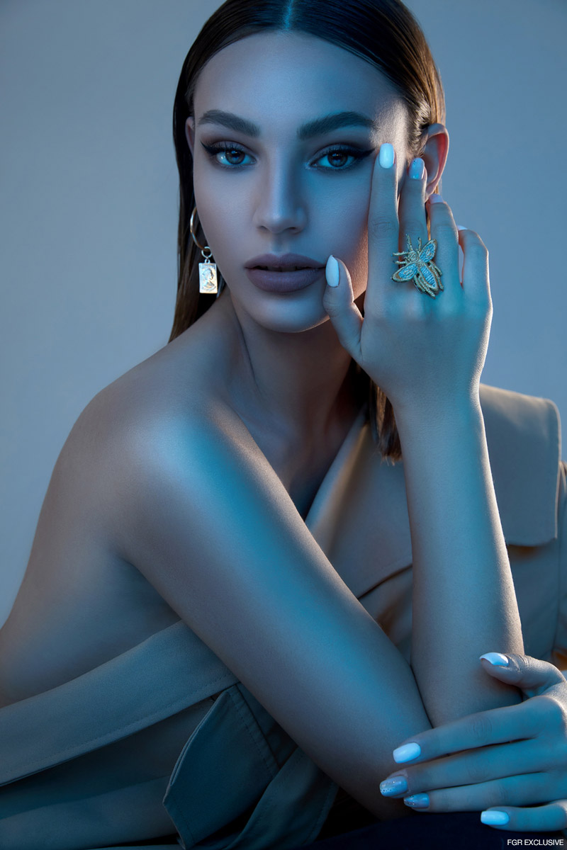 Coat Studio Pasha, Earrings C'CLAIR by YAM ASSOULIN, and Ring (Pin) Dior. Photo: Shilat Mizrahi