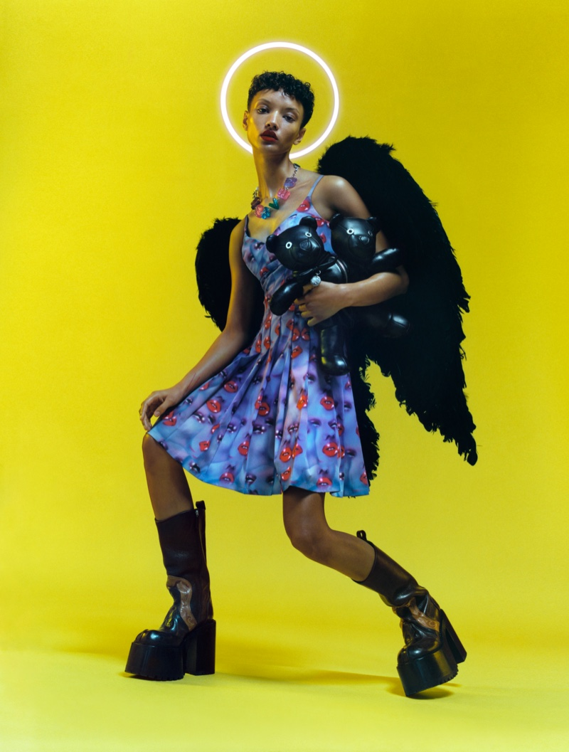 Wearing wings, Georgia Palmer poses for HEAVEN by Marc Jacobs spring-summer 2021 campaign.