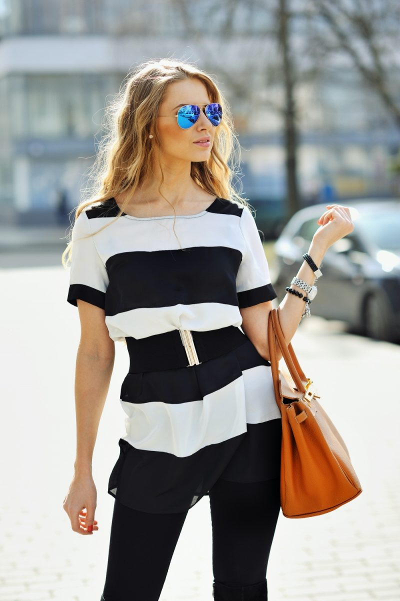 Model Wearing Cute Black and White Look with Blue Aviator Sunglasses