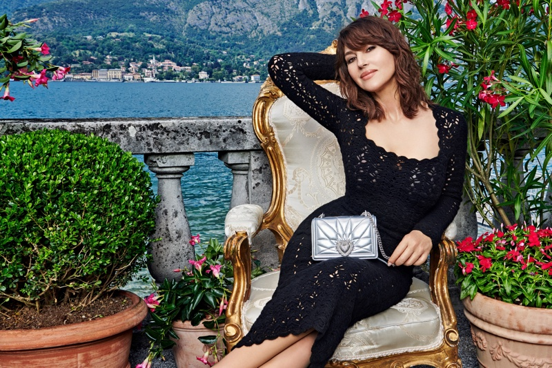 Actress Monica Bellucci models Dolce & Gabbana Devotion bag in silver.