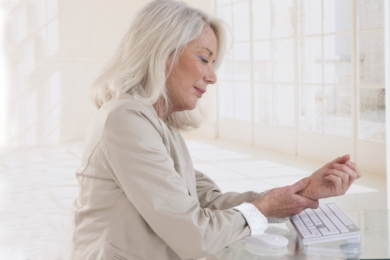 Older Woman Grey Hair Holding Wrist Keyboard