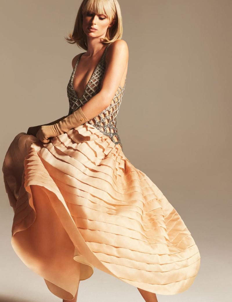 Modeling an embellished dress, Paris Hilton fronts Lanvin spring-summer 2021 campaign.
