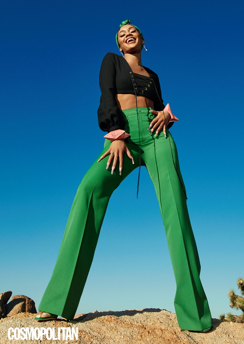 Taking a stand, Saweetie wears Gucci top, pants, carré, and bracelets with Giuseppe Zanotti heels.