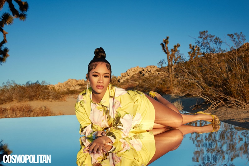Saweetie lays down in Valentino dress and Gianvito Rossi heels.