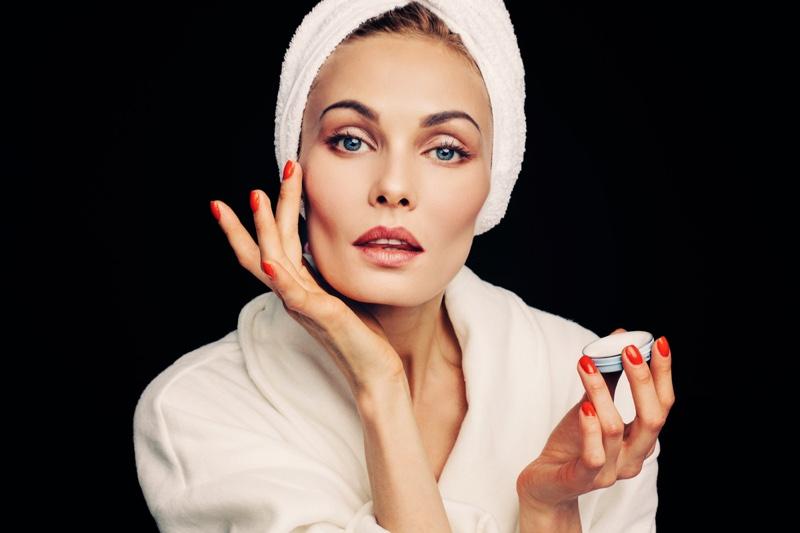 Woman Applying Face Cream Beauty Makeup