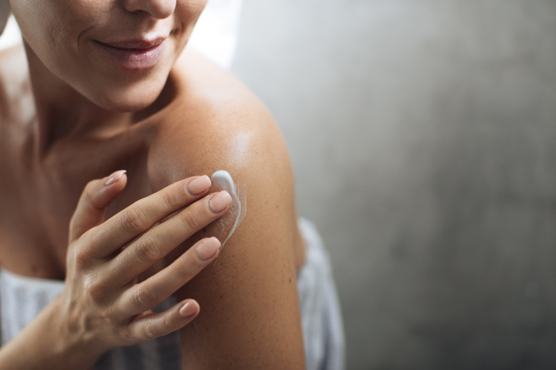 Woman Applying Lotion Cream Shoulder