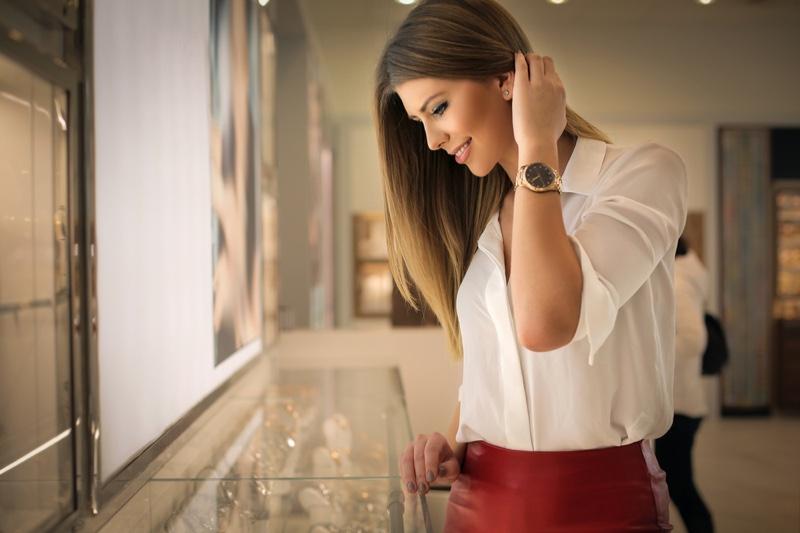 Woman Looking Jewelry Case Store Wearing Watch