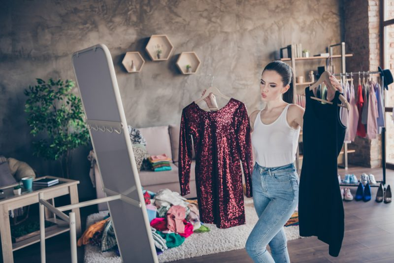 Woman Looking at Outfit Options