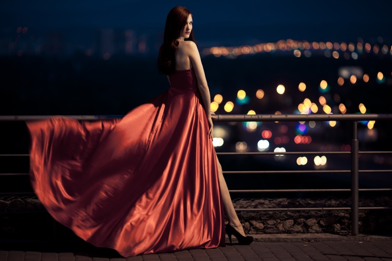Woman Red Gown Showing Leg Slit Night