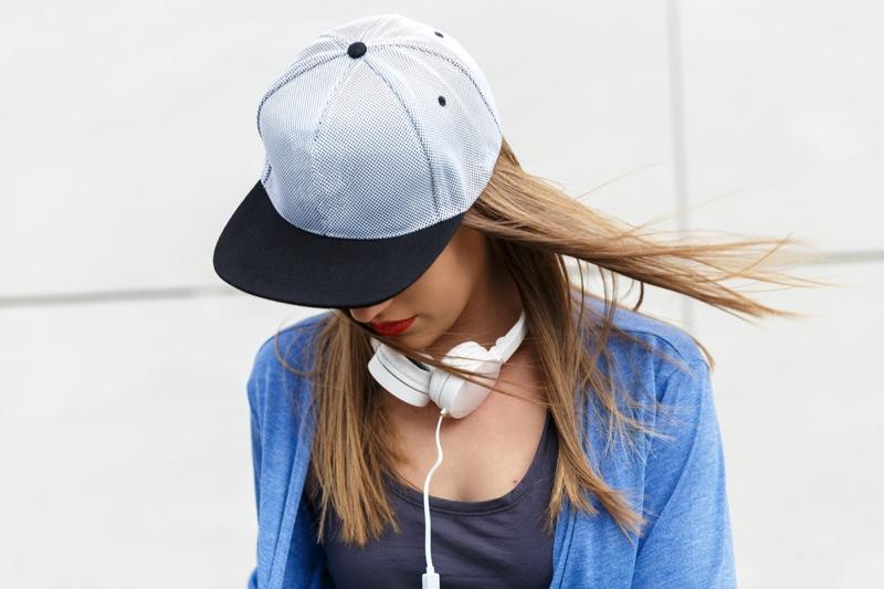 Woman Wearing Black White Baseball Cap Headphones