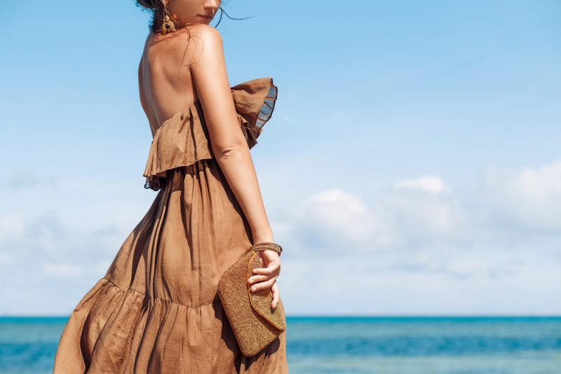 Woman Wearing Brown Dress at Beach