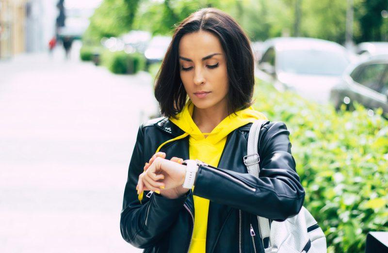 Woman in Hoodie and Leather Biker Jacket