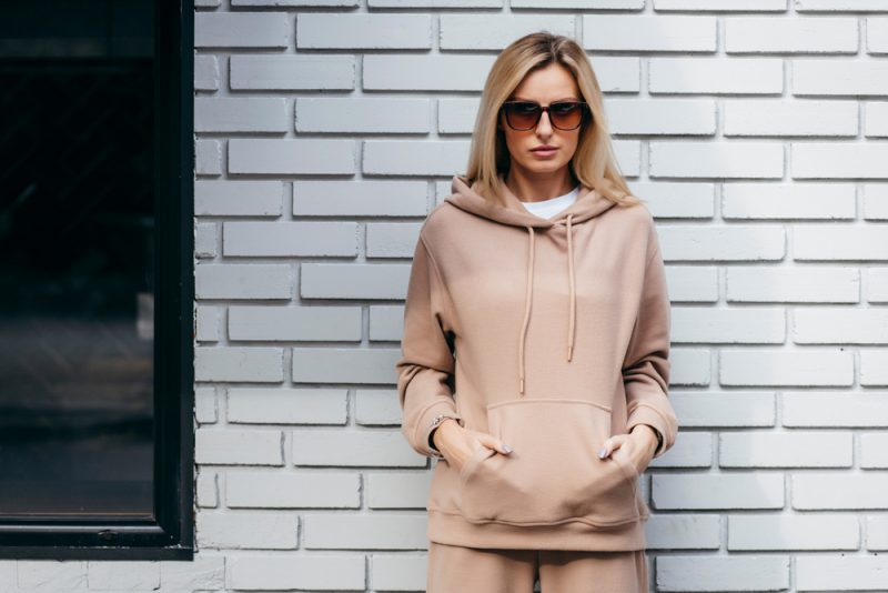 Woman in Hoodie and Sunglasses