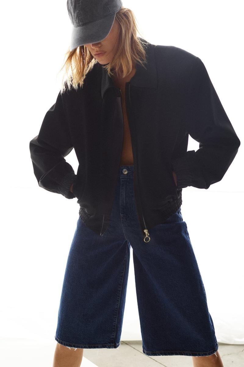 Anja Rubik wears Zara bomber Limited Edition and the '70s shorts ZW Premium.