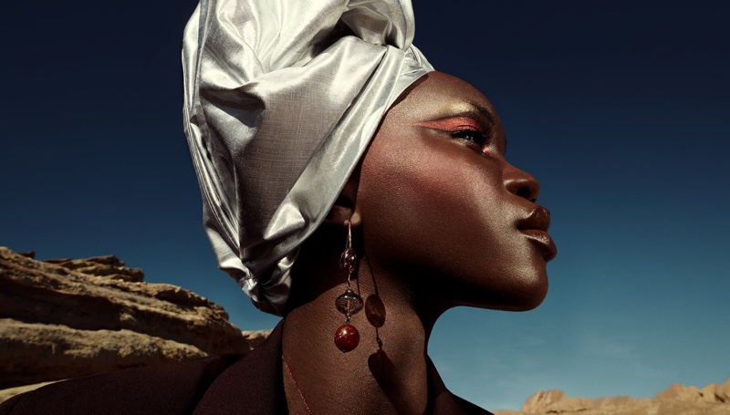 Achenrin Madit poses in Zara glass blown earrings for spring 2021 campaign.