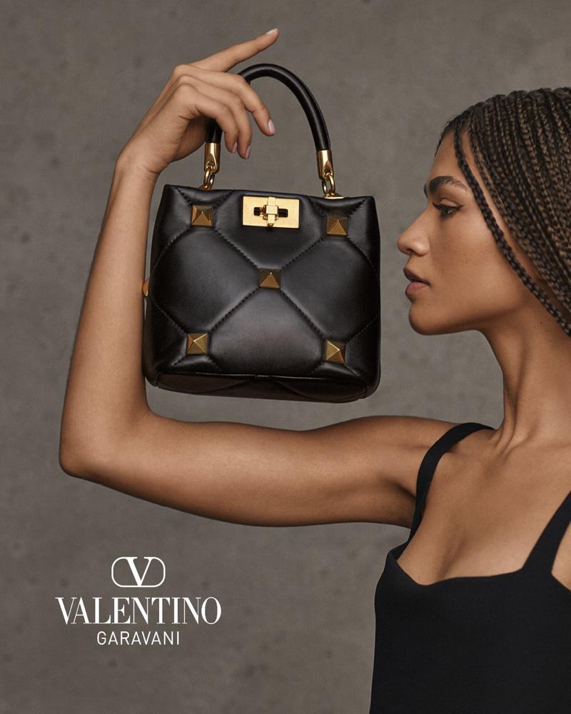 Actress Zendaya poses with Valentino Roman Stud top handle bag.