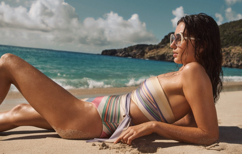 Zimmermann Swim highlights Mae scarf tie one-piece and Botanic geo frame sunglasses in summer 2021 campaign.
