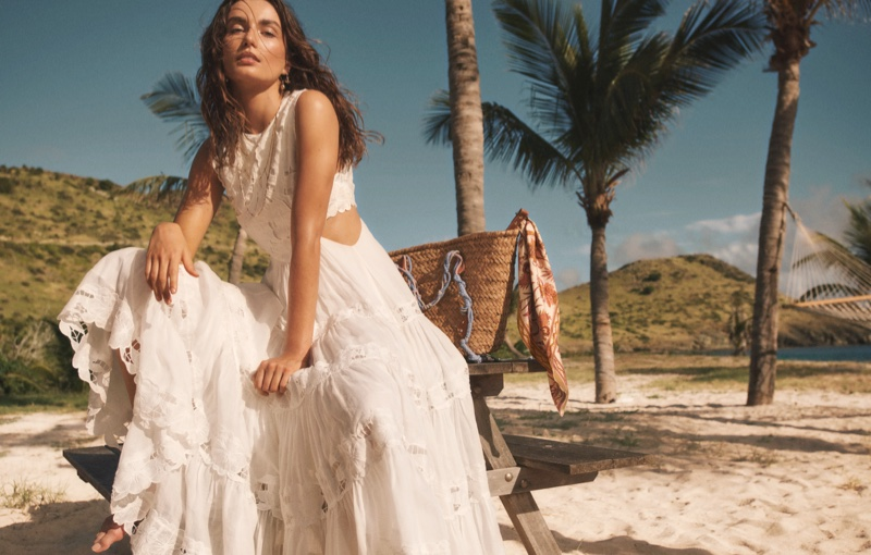 Andreea Diaconu poses in white beach dress for Zimmermann Swim summer 2021 campaign.