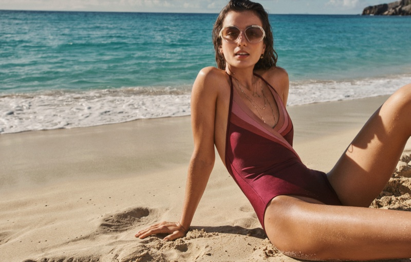 Zimmermann features Cassia Sunray one-piece in Swim summer 2021 campaign.