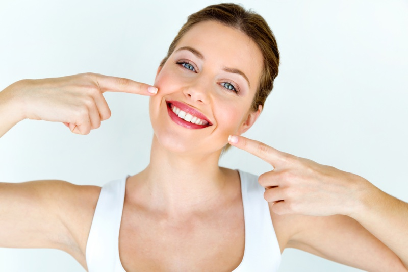 Attractive Smiling Woman Pointing Mouth