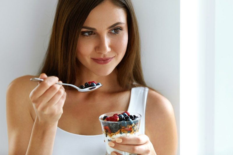 Attractive Woman Eating Berry Yogurt Food
