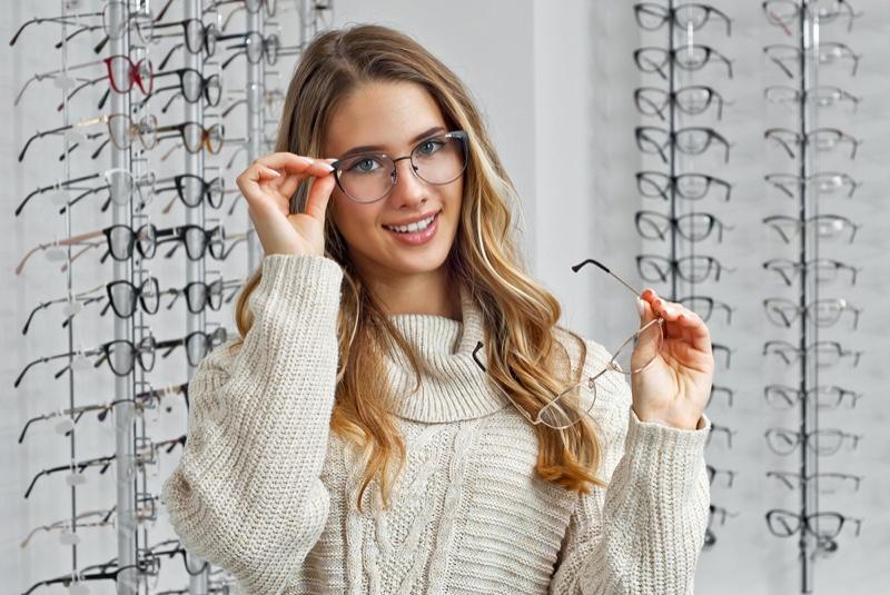 Blonde Woman Choosing Optical Glasses Store Display
