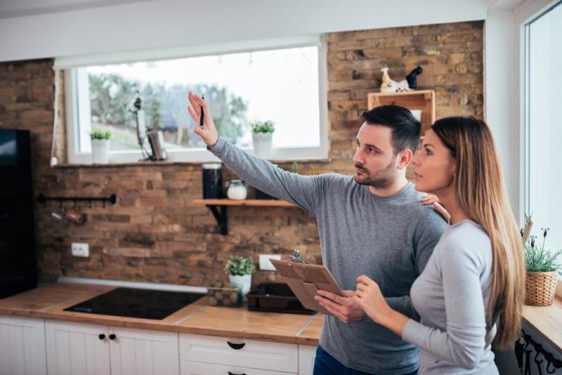 Couple Discussing Home Improvement Plans