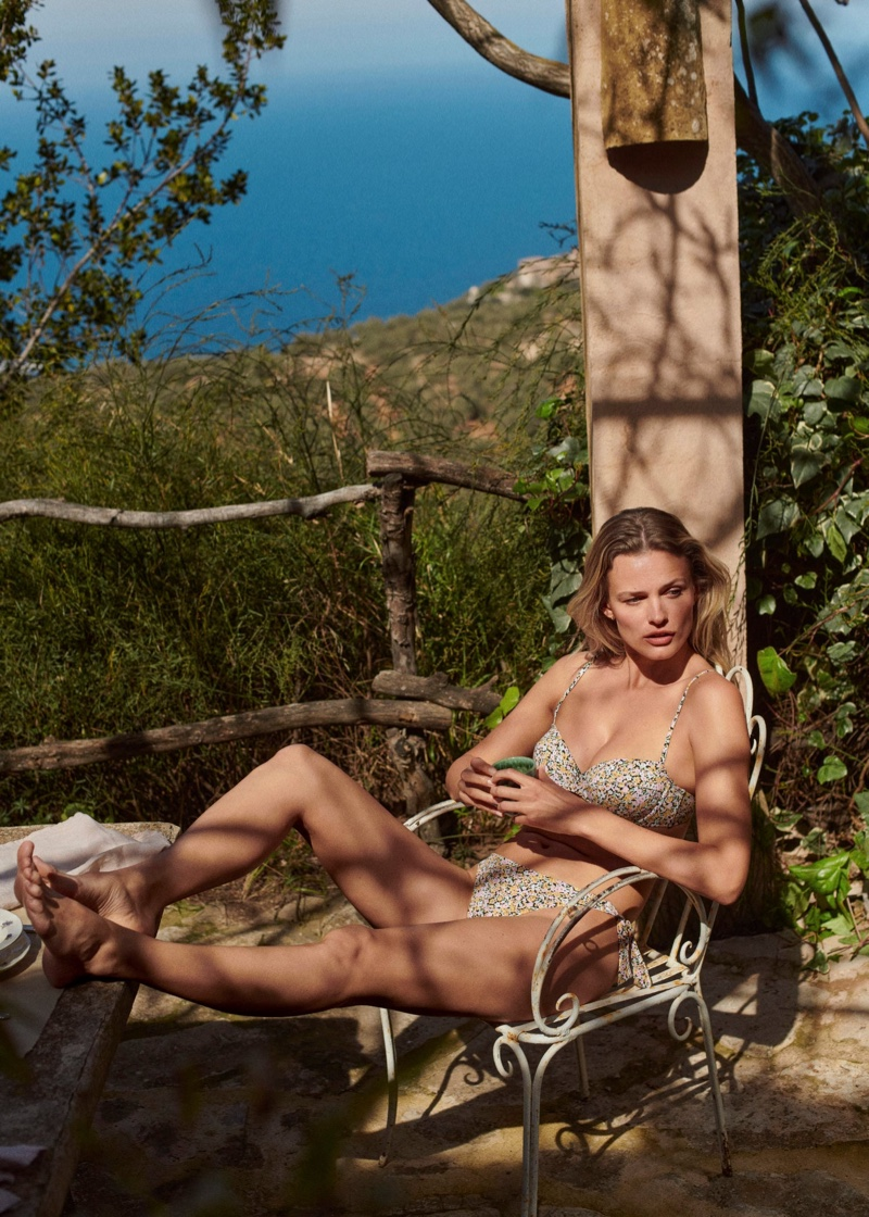 Lounging in the shade, Edita Vilkeviciute poses for Mango 2021 swimsuit collection.