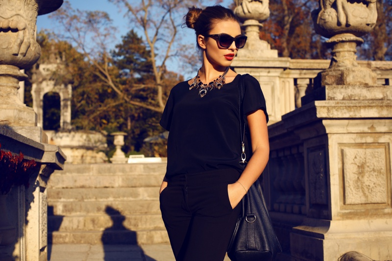Fashionable Woman All Black Outfit Statement Necklace