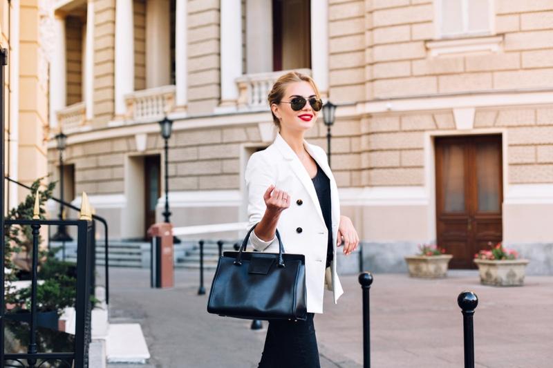 Fashionable Woman White Blazer Black Tote Bag Street