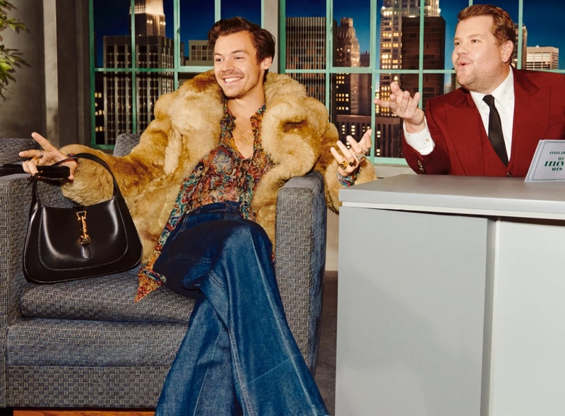 Harry Styles poses for Gucci Beloved Talk Show handbag campaign.