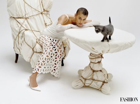 Gossip Girl star Jordan Alexander wears a Valentino dress while posing with a cat.