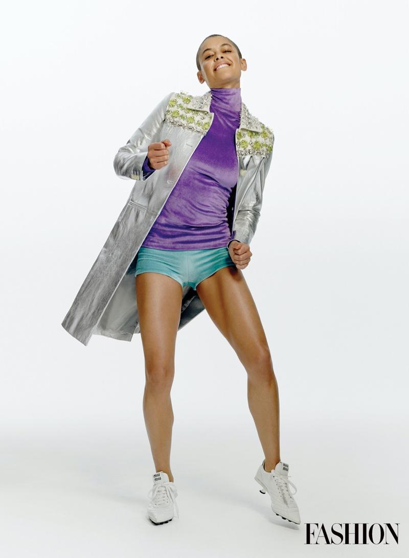 Looking sporty chic, Jordan Alexander poses in Miu Miu outfit.