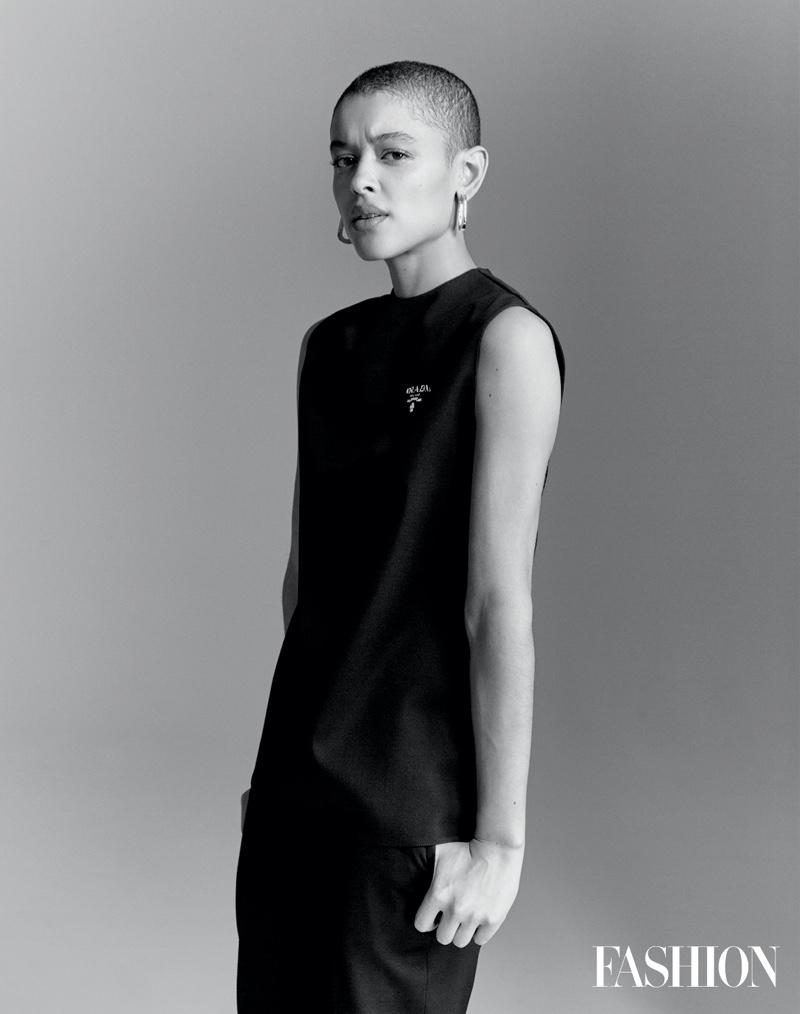 Actress Jordan Alexander poses in Prada top and pants with Jenny Bird earrings.