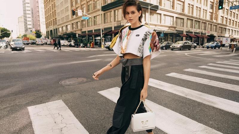 Kaia Gerber stars in Louis Vuitton Twist bag summer 2021 campaign.