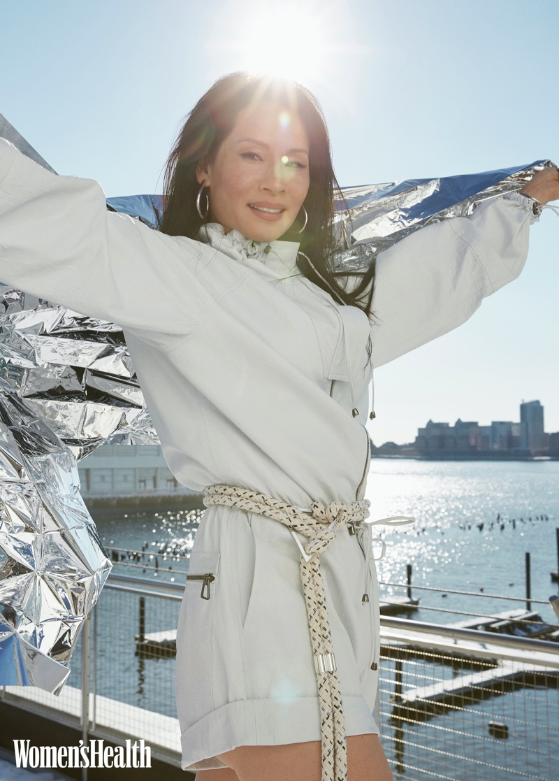 Lucy Liu wears Dodo Bar Or jumpsuit, Iro belt, and Jennifer Fisher jewelry.