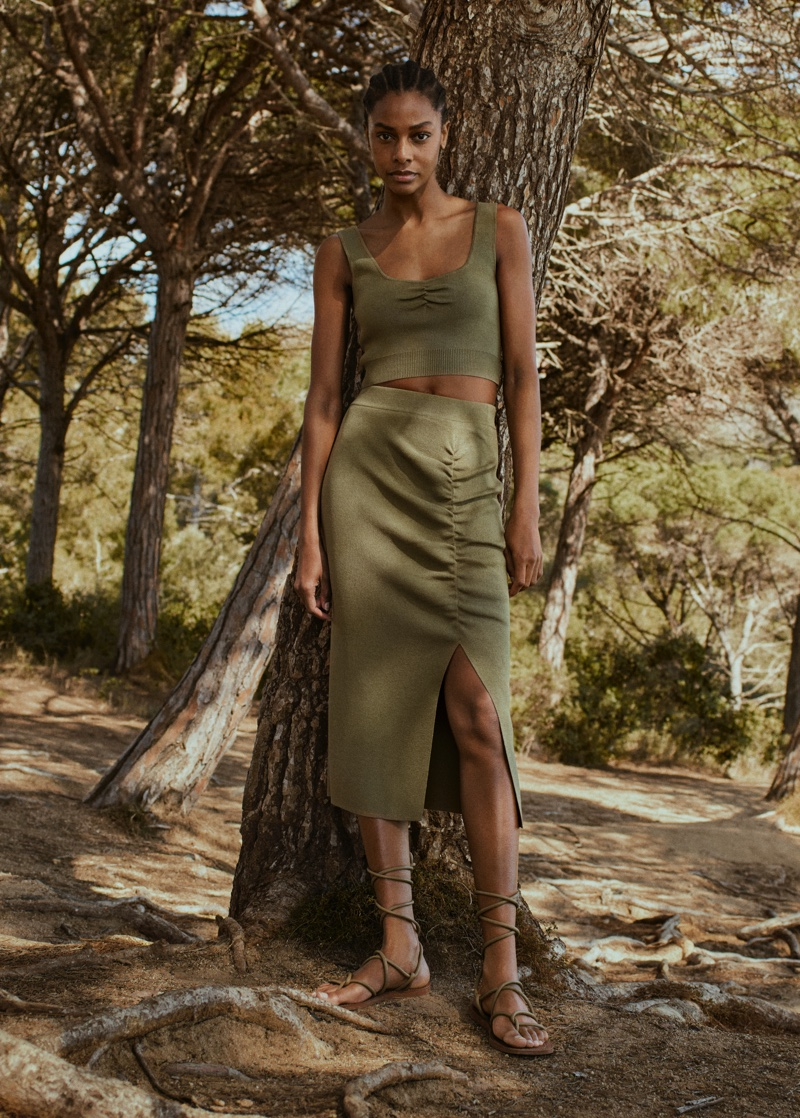 Karly Loyce poses in neutral fashion for Mango Committed Effortless spring-summer 2021