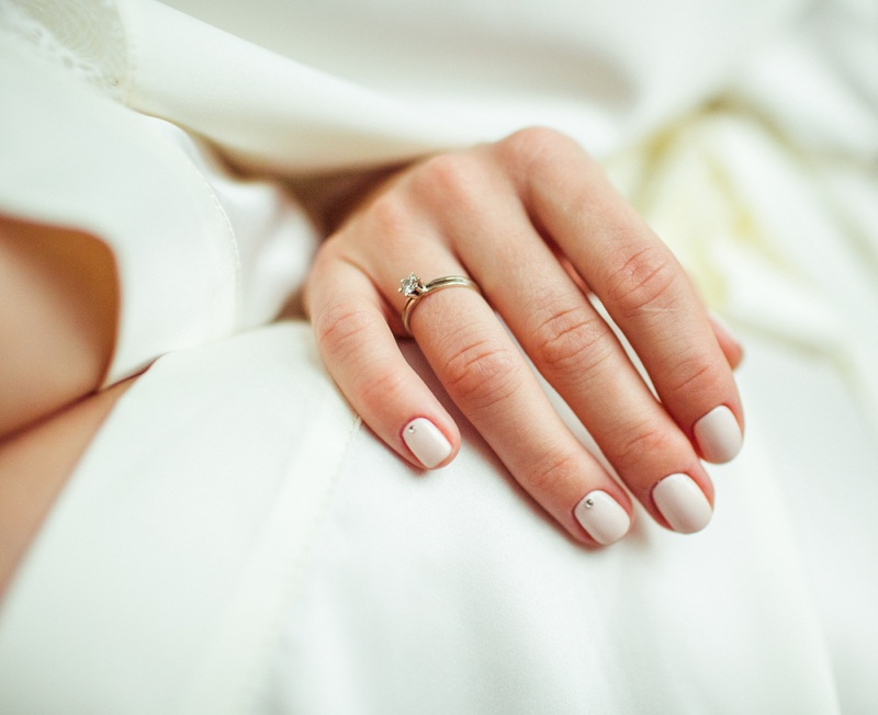 Manicured hands Wearing Diamond Ring