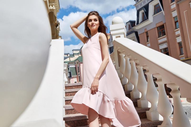 Model Pink Ruffle Hem Dress Staircase Outside Sun