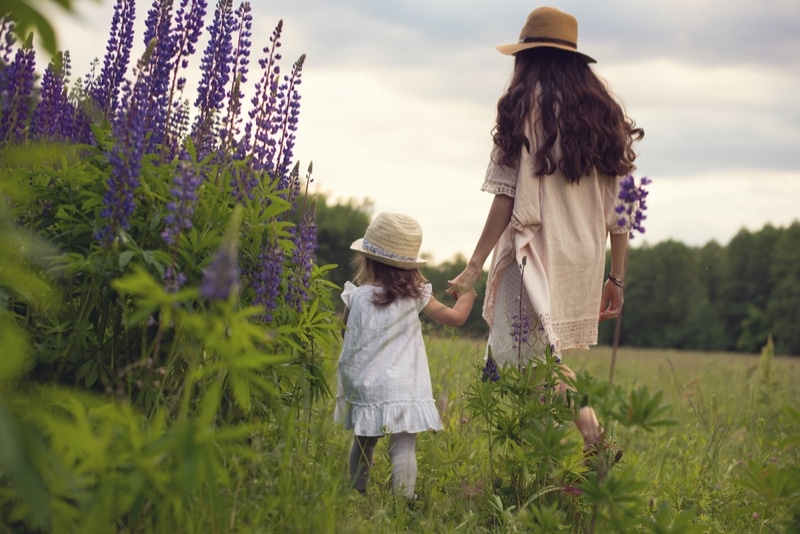 Mother Daughter Boho Style Outdoors Walking Grass